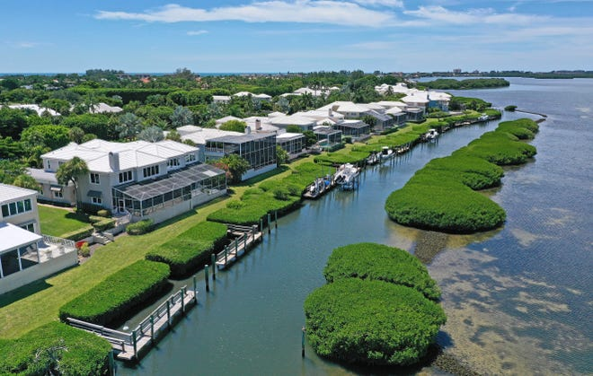 Located on the widest section of Longboat Key, Corey's Landing offers some of the most spectacular, panoramic views of Sarasota Bay. The enclave of single-family, luxury residences is safely tucked away behind two gates on Harborside Drive.
