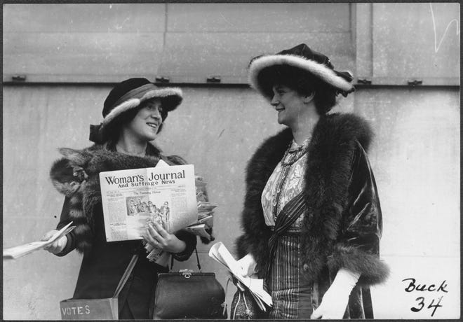 Margaret Foley, left, distributing The Woman's Journal during the push for ratification of the 19th Amendment, which came in 1920.