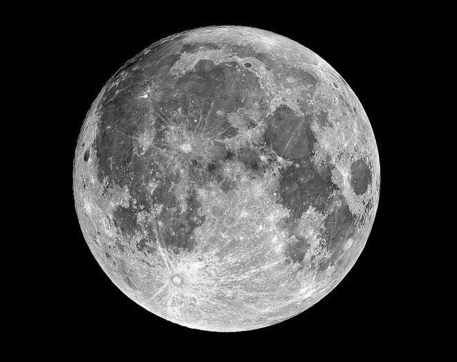 The full moon, shown in a file photograph made through the author's 12.5-inch telescope, will be designated the 2020 harvest moon when it rises on Oct. 1.  [Photo by Johnny Horne for the Fayetteville Observer]