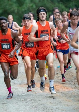 Former South View runner Brian Odom, right, died Sunday from injuries suffered in a skateboarding accident. He was 20.