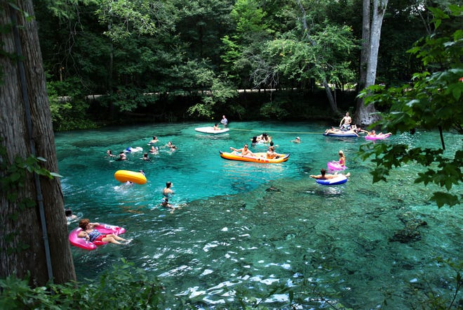 People swim in the main spring at Ginnie Springs near High Springs. [Gainesville Sun, File]