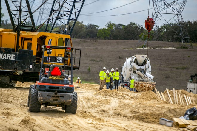 Crews work on the Suncoast Parkway in Hernando County in 2019. The M-CORES plan would extend the toll road through levy County. [Alan Youngblood/Gainesville Sun]