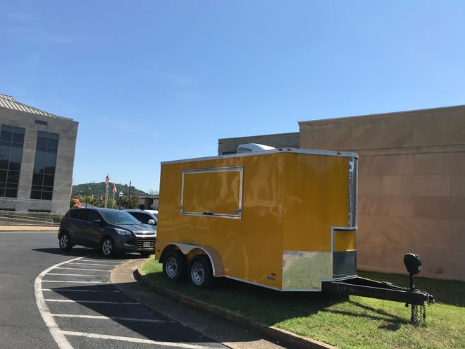 Etowah County Probate Judge Scott Hassell purchased a trailer with discretionary funds to offer drive-thru service for people reluctant to come in the courthouse because of COVID-19.