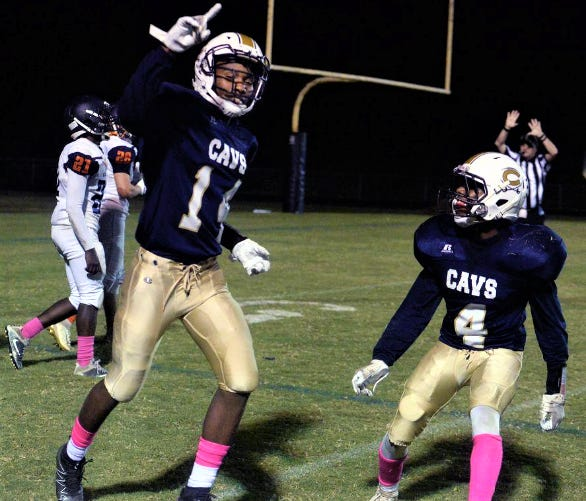 Cummings High School's Torree Trollinger, left, celebrates with teammate Dylantae James in a game against Bartlett Yancey.