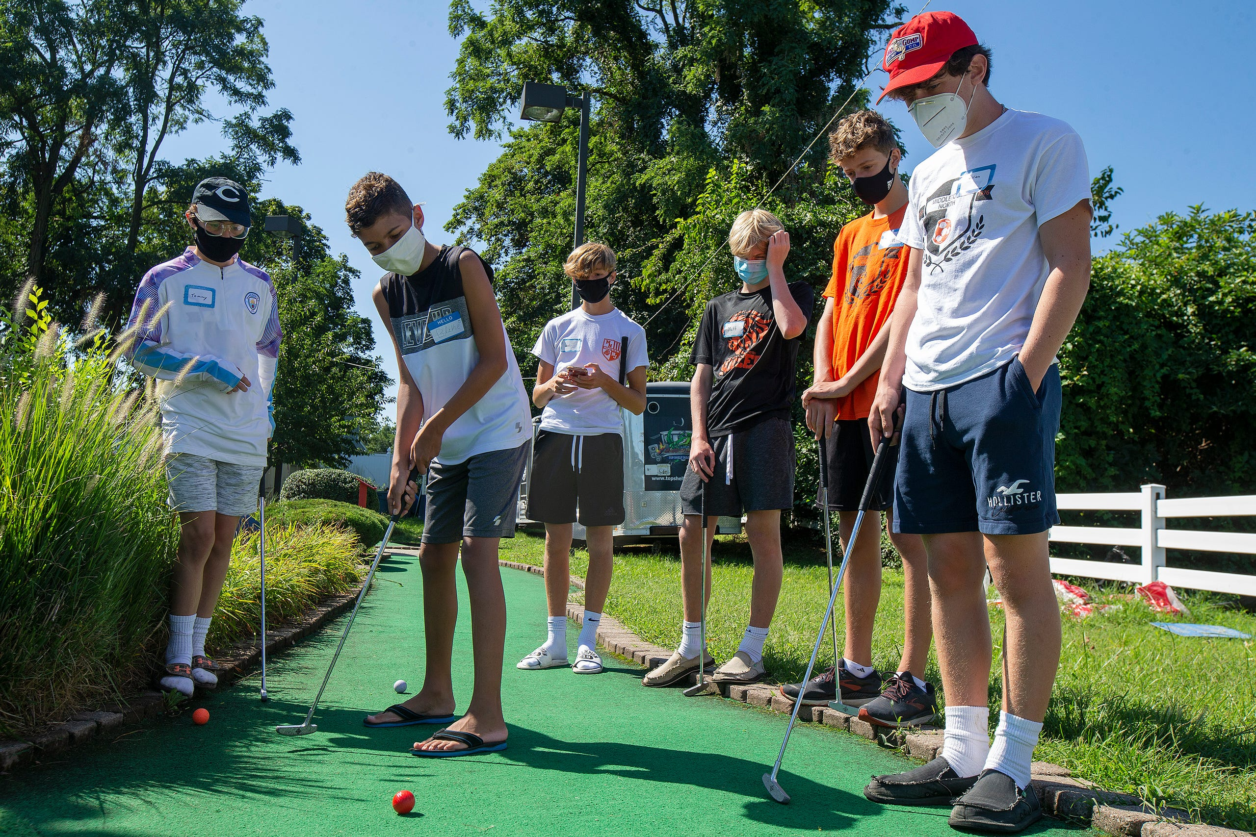 (center) Blake Illingworth, 13, of Middletown plays mini-golf with members of the Middletown North boys soccer team as part of Friends Connect Foundation, a nonprofit run by Sophia Ziajski, 19, of Middletown, atTST BBQ & Mini Golf in Middletown, NJ Tuesday, August 18, 2020.