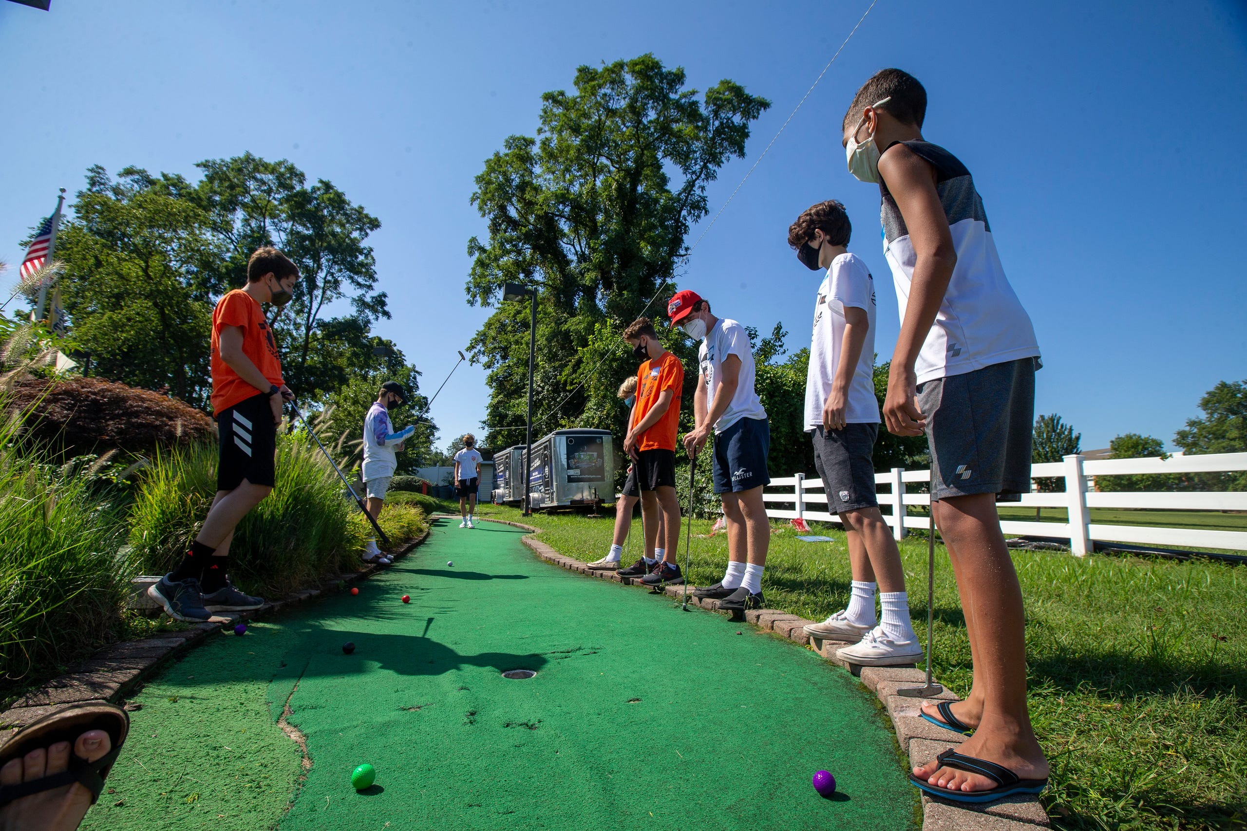 (right) Blake Illingworth, 13, of Middletown plays mini-golf with members of the Middletown North boys soccer team as part of Friends Connect Foundation, a nonprofit run by Sophia Ziajski, 19, of Middletown, atTST BBQ & Mini Golf in Middletown, NJ Tuesday, August 18, 2020.