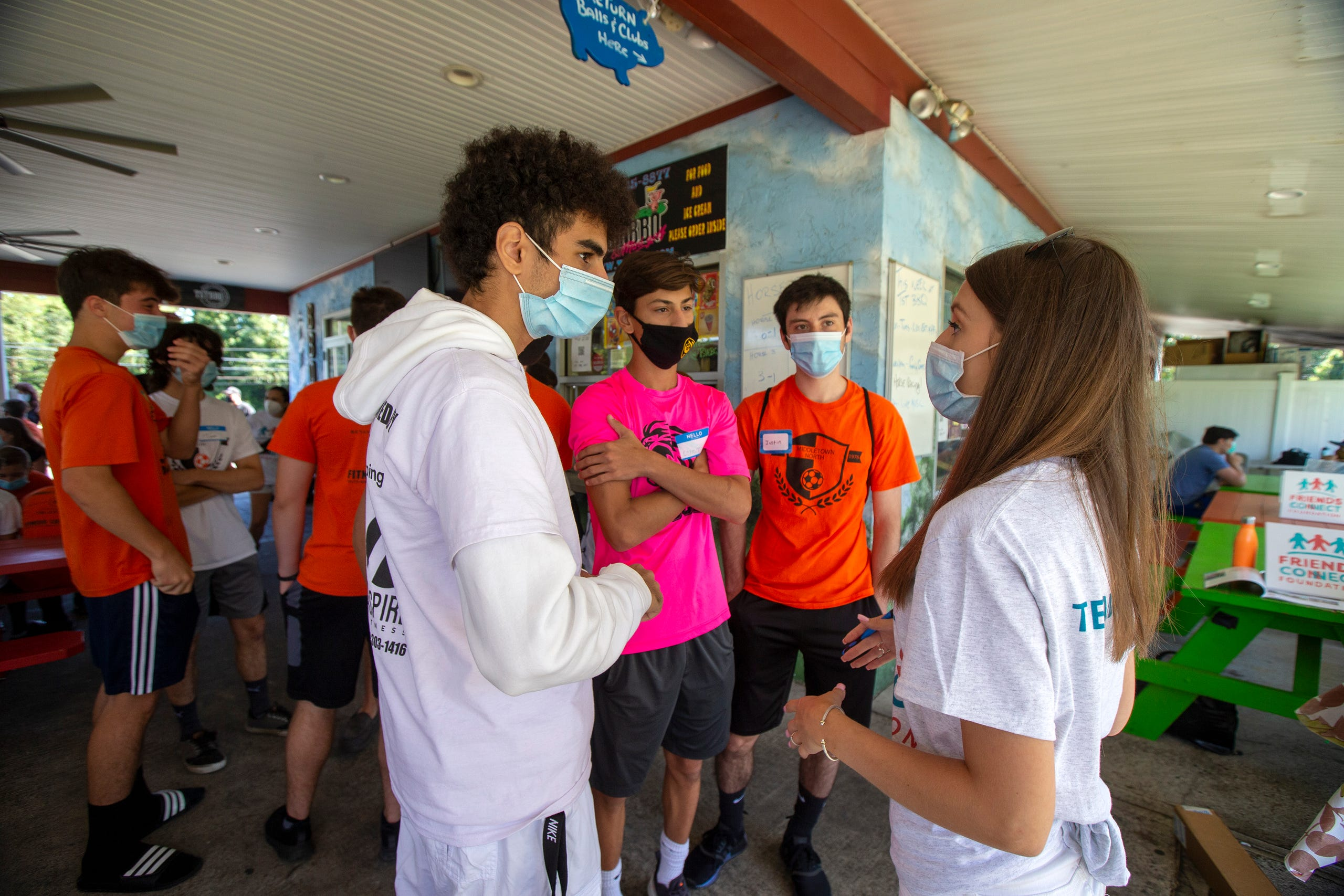 Sophia Ziajski, 19, of Middletown speaks to members of the Middletown North boys soccer team who will play mini-golf with special-needs children and adults as part of Friends Connect Foundation, a nonprofit run by Sophia Ziajski,, at TST BBQ & Mini Golf in Middletown, NJ Tuesday, August 18, 2020.