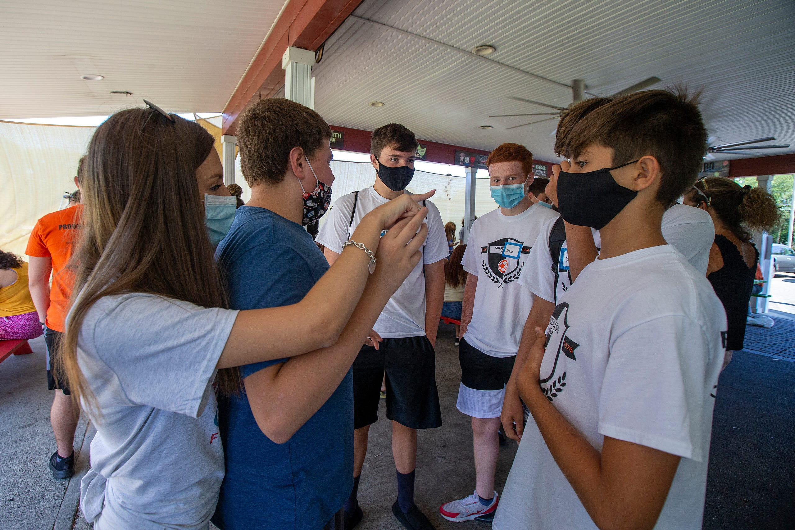 Sophia Ziajski, 19, of Middletown introduces Marc Corallo, 12, of Middletown to members of the Middletown North boys soccer team who will play mini-golf with him as part of Friends Connect Foundation, a nonprofit run by Sophia Ziajski,, at TST BBQ & Mini Golf in Middletown, NJ Tuesday, August 18, 2020.