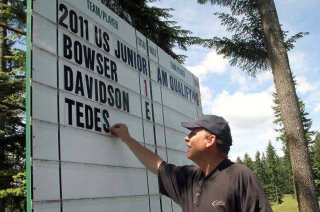 Scott Alexander places the leaderboard during the 2011 United States Junior Amateur tournament at Gold Mountain in Bremerton. A year later he retired from the course, where he worked for 28 years and helped develop two 18-hole courses, and with his wife Ivaly has remained devoted to community causes.