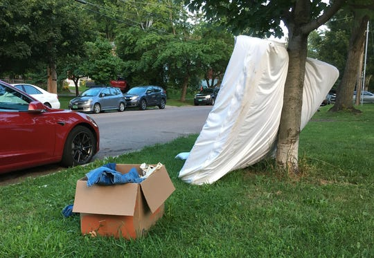 A discarded mattress is left on a St. Paul Street greenway in Burlington on Aug. 17, 2020. Mattresses are costly to junk, take up valuable landfill space and are difficult to recycle.