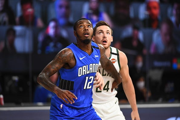 Gary Clark #12 of the Orlando Magic looks for the ball during the game against the Milwaukee Bucks during Round One, Game One of the NBA Playoffs on August 18, 2020 at The Field House at ESPN Wide World Of Sports Complex in Orlando, Florida.