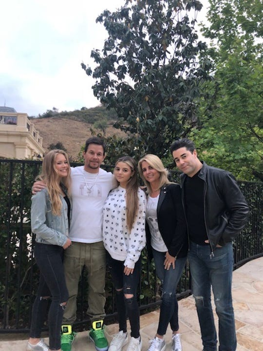 Mark Wahlberg and Jay Feldman's daughters, Ella Rae Wahlberg and Sara Feldman, have become friends along with their dads.  The two families gathered in 2019 at Mark's home in Beverly Hills, Calif.  L to R:  Ella Rae Wahlberg, Mark Wahlberg, Sara Feldman, Ann Feldman and Jay Feldman.