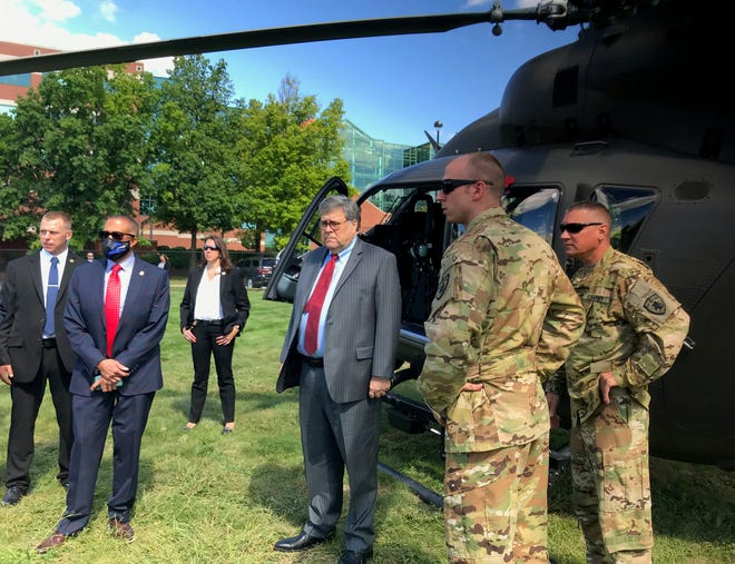 U.S. Attorney General William Barr, center, visits Detroit to assess a federal crime initiative that involves 42 federal agents coming to town to help fight escalating gun violence.