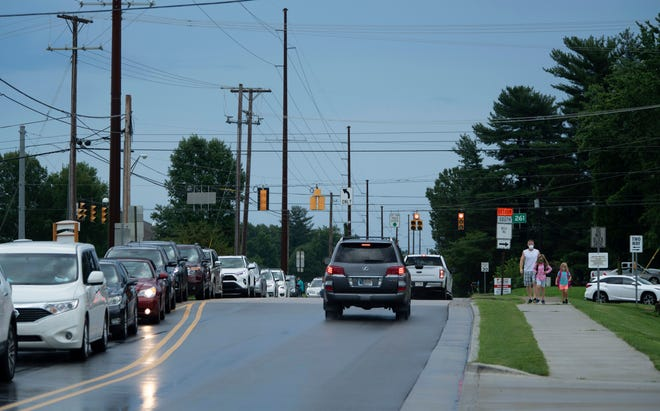 Vehicles with students are backed up from the parking lot on Oak Grove Road to IN 261 (and beyond) as school drop-offs begin at J.H. Castle Elementary School in Paradise, Ind., Friday morning, Aug. 14, 2020.