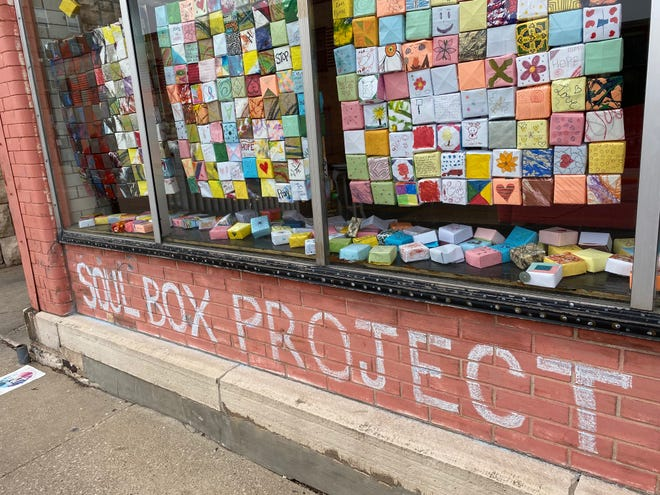 Soul Box Project exhibit displayed in the windows of Trista Holz Studios.