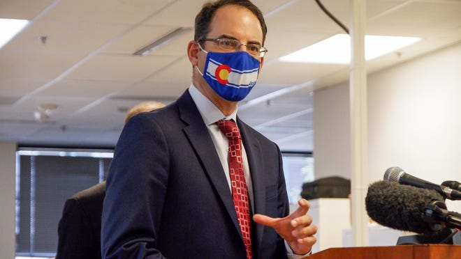 Colorado Attorney General Phil Weiser speaks to reporters at a news conference Monday, Aug. 17, 2020, on mail-in voting.