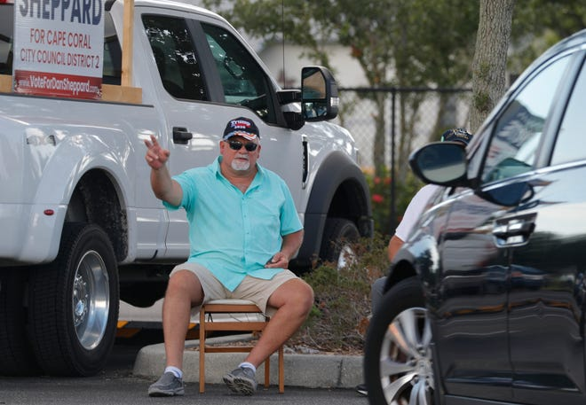 Dan Sheppard, a candidate for Cape Coral City Council District 2, waves to potential voters on election day Tuesday, Aug. 18, 2020, at the city library voting precinct.