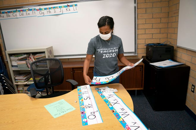 Denise Castro, second grade teacher at Spring Creek Elementary, sets up her classroom in Bonita Springs on Tuesday, August 18, 2020.