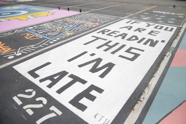Local seniors paint parking spots before start of new school year