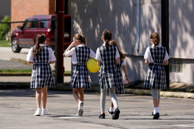 Fourth graders play during recess at St. Boniface School, Tuesday, Aug. 18, 2020 in Lafayette.