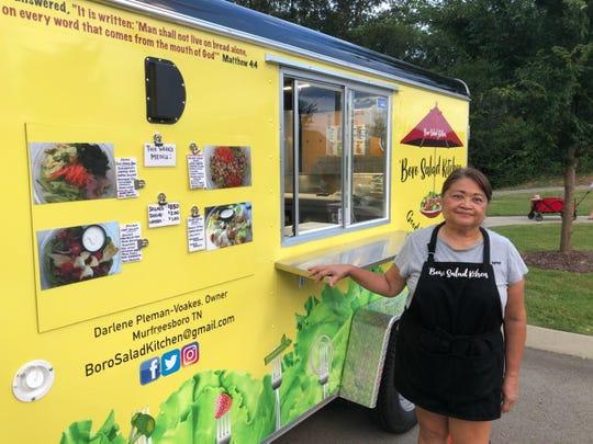 Darlene Pleman-Voakes stands beside her new food truck, Boro Salad Kitchen.