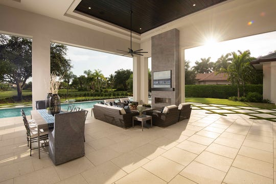 Streamsong 5,295 square foot under air grand estate at Quail West showcases interior design by Theory Design's Ruta Menaghlazi and Adriene Ged and features a 1,191 square foot outdoor living area.