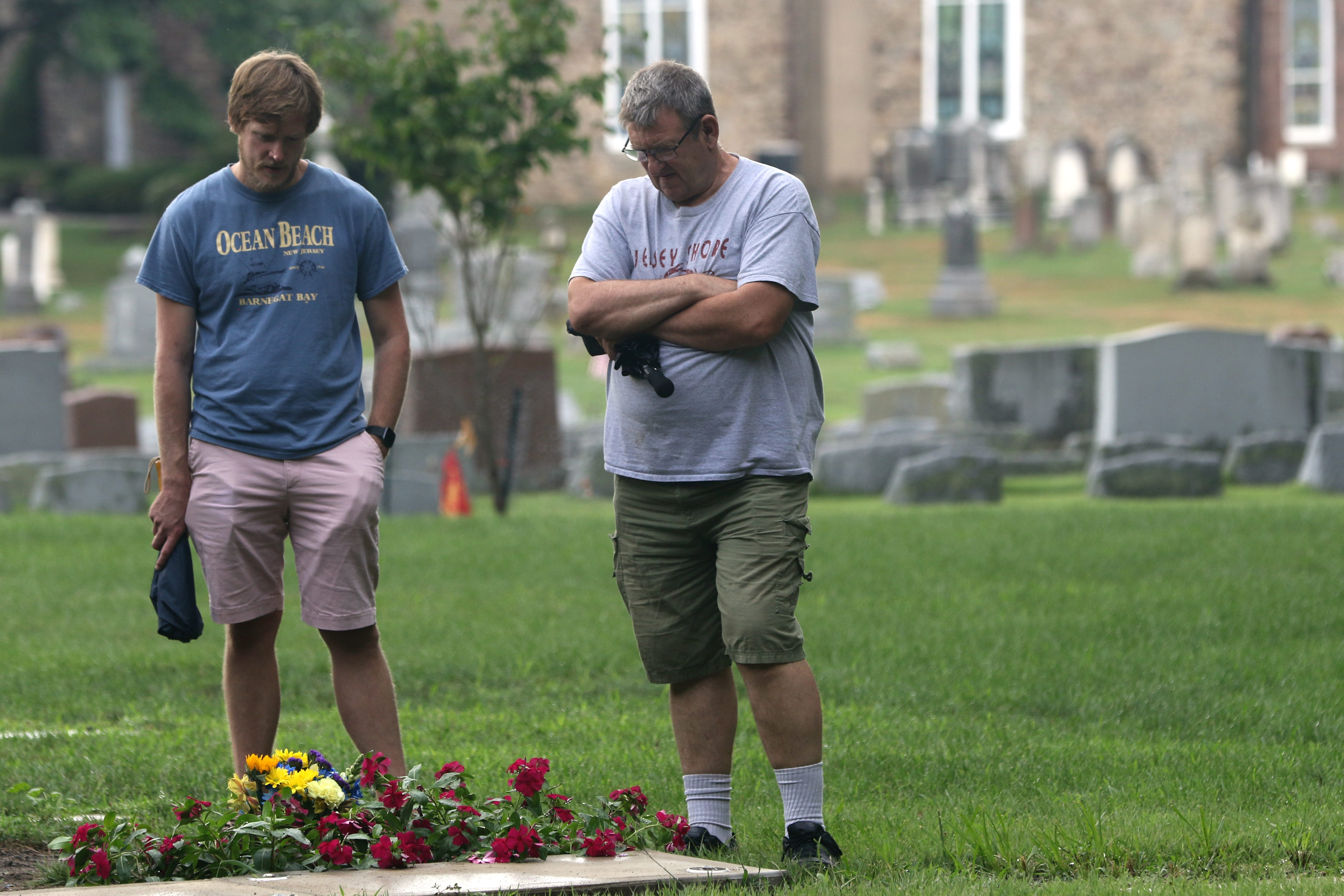 The Birchenough family walks away from Barbara's grave.