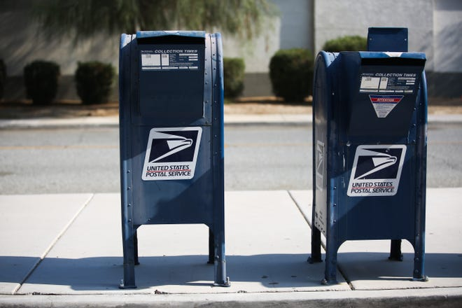 Mail boxes sit outside of a U.S. Post Office on Tuesday, August 18, 2020, in La Quinta, Calif.