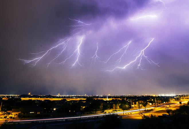 Lightning strikes as a monsoon storm blows over Mesa on Aug. 17, 2020.