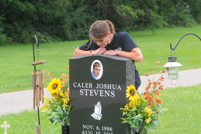 Tara Stevens visits the grave of her son, Caleb Stevens, who was killed five years ago inside his home.