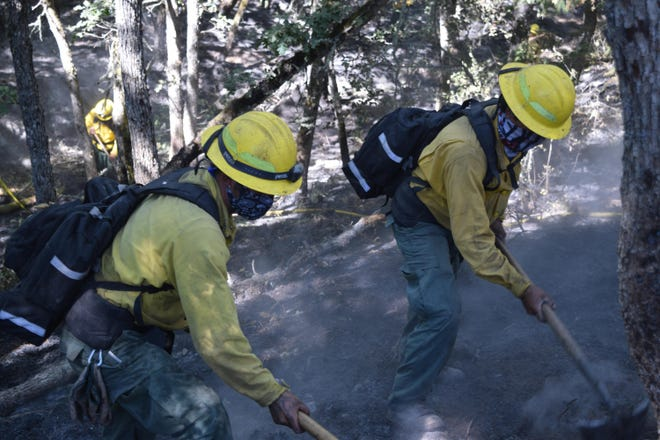 Members of a hand crew working on mop-up operations on the Mosier Creek Fire on Saturday, August 15, 2020.