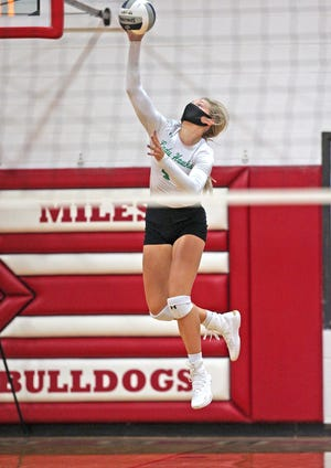 Kamryn Williams serves for Wall during a game against Miles on Tuesday, Aug. 18, 2020.