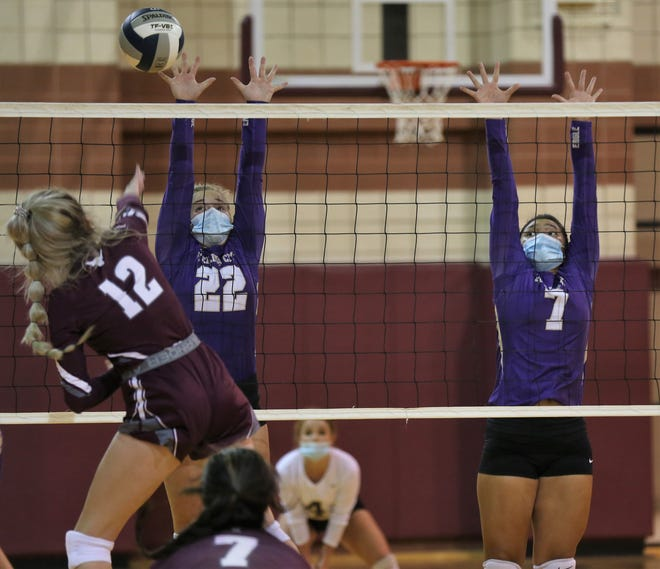 Sterling City's Peighton Glass, center, and Jocelyn Palos try to block an attack by Bronte's Katelyn Powell in a nondistrict volleyball showdown at Bronte High School on Monday, Aug. 17, 2020.
