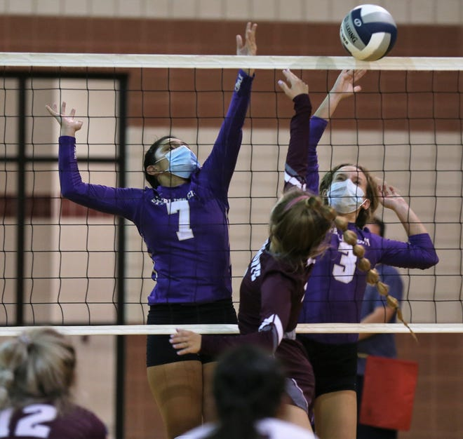 Sterling City's Jocelyn Palos, 7, and Kate Barnes battle at the net with Bronte's Saige Busby in a nondistrict volleyball showdown at Bronte High School on Monday, Aug. 17, 2020.