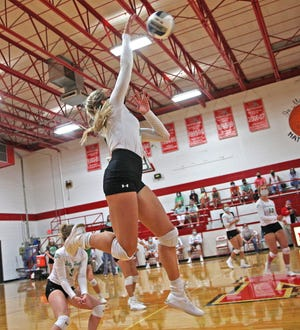 Kamryn Williams spikes the ball for Wall during a game against Miles on Tuesday, Aug. 18, 2020.