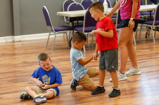 Kids count to ten as they play a game at Pat Jones YMCA on Tuesday, August 18, 2020.