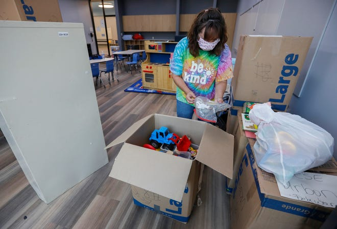 Janet Urbon, an early childhood special education teacher, unpacks boxes in her classroom at Delaware Elementary School on Aug. 17. Today is the first day of the school year.
