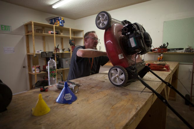 Residents and staff work on small engines at a Switchpoint facility in St. George Tuesday, Aug. 18, 2020. Jobs come from donations made to Switchpoint as well as local companies needing repair and maintenance on their company machines.