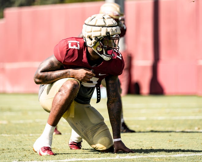 FSU defensive end Joshua Kaindoh prepares to rush during the Seminoles' practice August 18, 2020.