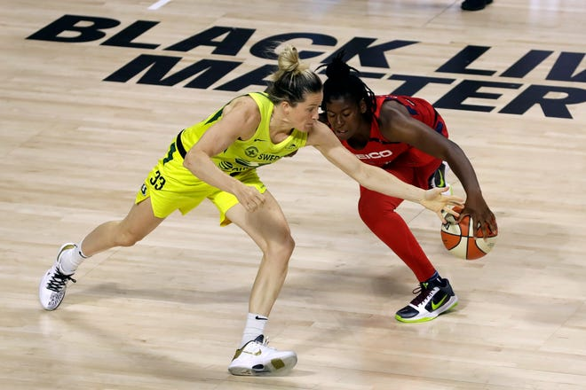 The Seattle Storm's Sami Whitcomb, a Buena High graduate, steals the ball from the Washington Mystics' Ariel Atkins during a game on July 30 in the WNBA bubble in Bradenton, Fla.