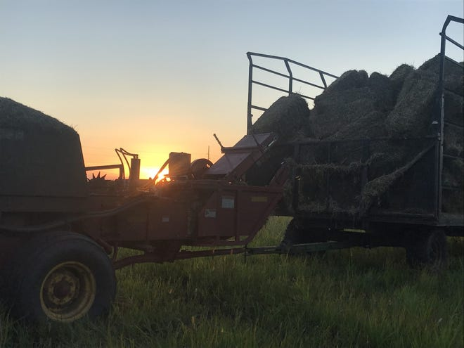 The sun sets on another long day of baling wheat straw in Fond du Lac County.