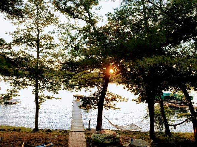 Author Jerry Apps captures a sunset across Long Lake on the Chain o' Lakes near Waupaca.