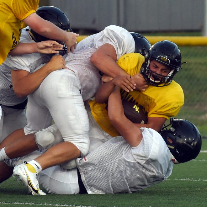 Tri-Valley's football team held an intrasquad scrimmage on Monday night at Jack Anderson Stadium. Teams were given the blessing of Gov. Mike DeWine and the Ohio High School Athletic Association on Tuesday to continue their seasons during COVID-19.