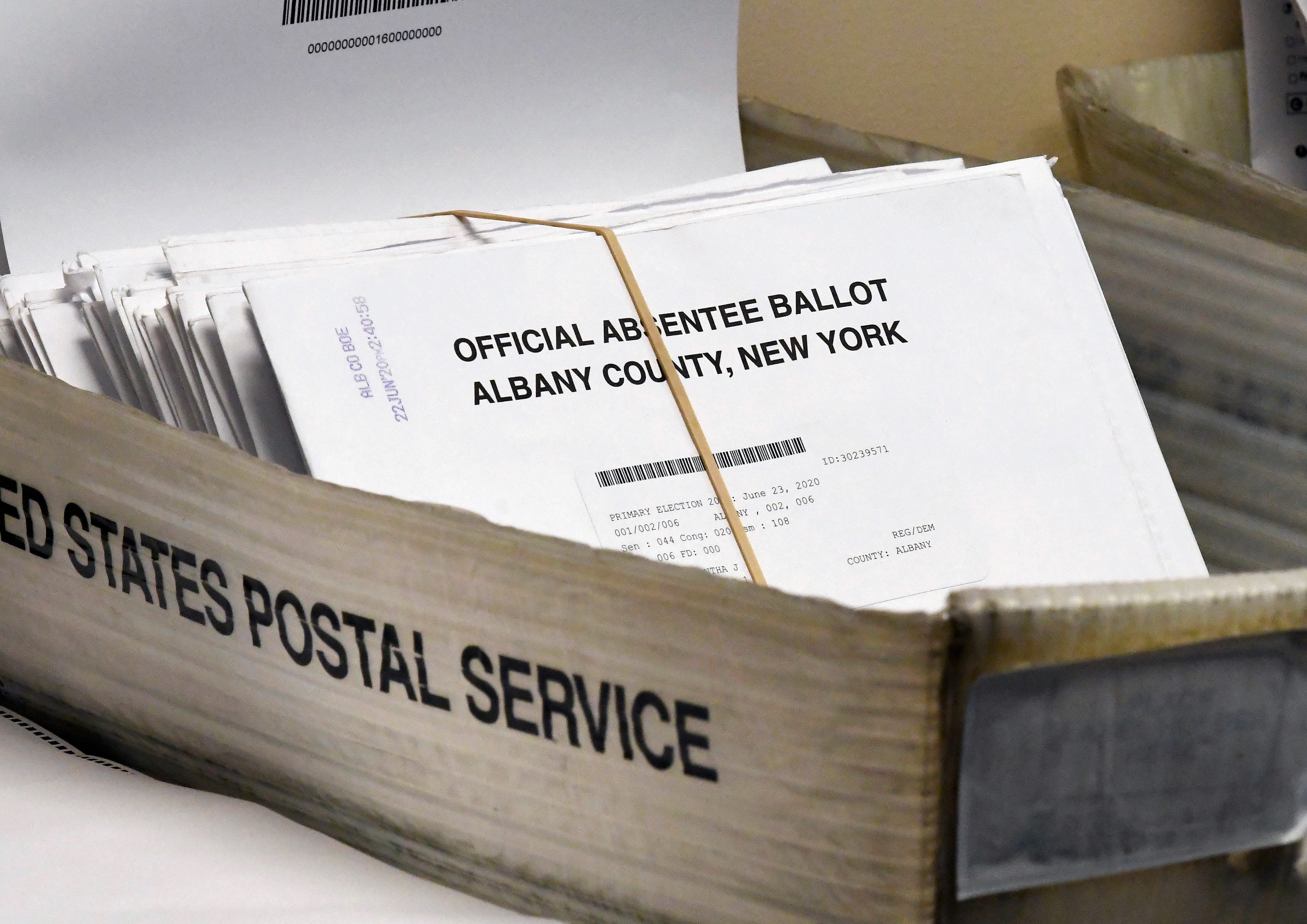 Absentee ballots wait to be counted at the Albany County Board of Elections in Albany, N.Y., on June 30, 2020.