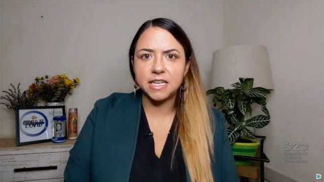 Kristin Urquiza, seen speaking at the 2020 Democratic National Convention, blames the messaging of former President Donald Trump for her father's death from COVID, but says his cable-news enablers bear some responsibility.