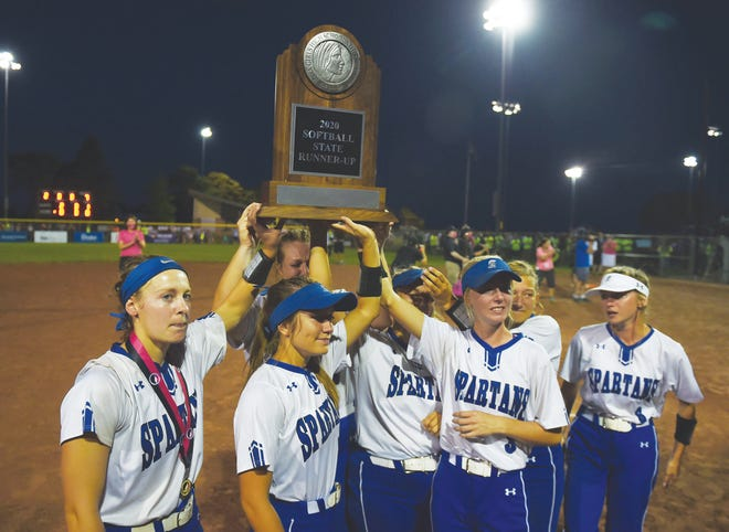 The Collins-Maxwell softball team raises the runner-up trophy after losing to Clarksville 2-0 in the Class 1A state championship game.
