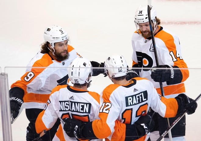 The Flyers' Michael Raffl, 12, is congratulated by teammates, from left, Ivan Provorov, Matt Niskanen and Sean Couturier after scoring in Game 4 Tuesday against the Canadiens.