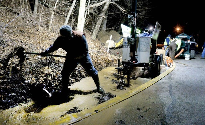 Aliquippa Municipal Authority employees work on a water main break on Franklin Avenue and Orchard Street in December 2015. [ECL file]