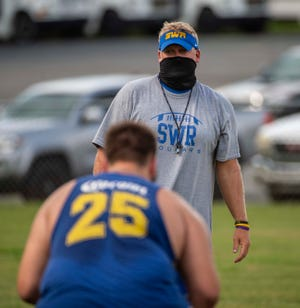 Southwestern Randolph head coach Seth Baxter watches during the Cougars' last summer football work out last Friday. PJ WARD-BROWN/ THE COURIER-TRIBUNE