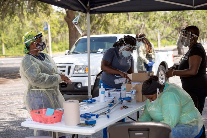 Health care workers administer tests for COVID-19 at Lake Sumter State College in Leesburg. [Cindy Peterson/Correspondent]